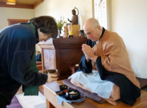 Laurie Senauke dishes up an oryoki serving in the zendo at Berkeley Zen Center.