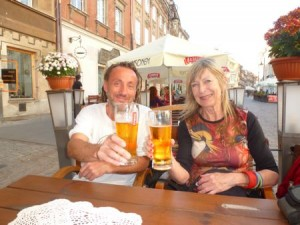 The author and a friend from Warsaw clink glasses.